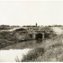 Men standing at the headgate on an irrigation ditch in San Joaquin ...