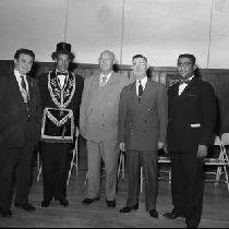 Al Fulcher (2nd from the left) standing with four men