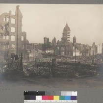 [Ruins and debris. City Hall in background.]