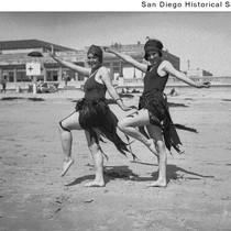 Bobbie Harmon and Mary Malloy posing on a beach wearing bathing suits ...