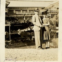 Al and Mary Tsukamoto standing in front of pond