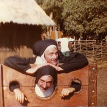 Bobbi Campbell and man dressed as nuns in pillory