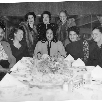 May Mooreland and Mrs. Elsie Jenkins (back row, center) posing with six ...