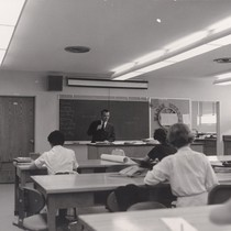 Photograph of instructor and students in classroom