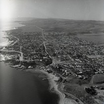 Aerial view of coast and unidentified city near Orange County, California: Photograph