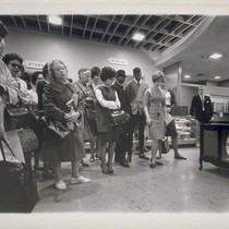 Shocked people in Emporium watch television reports of Kennedy's assasination