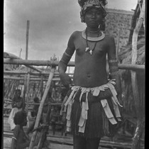 Adamase, a Motu woman of Gaile village, wearing crescent kina shell valuable ...