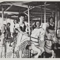 The 1949 Cherry Festival Queen and her Court riding a merry go ...