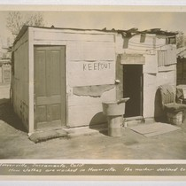 Hooverville, Sacramento, California. How clothes are washed in Hooverville. The washer declined ...
