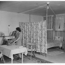 A typical interior of a barracks home.--Photographer: Parker, Tom--Denson, Arkansas. 11/18/42