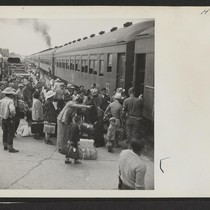A scene at Delta, Utah, as passengers from the Topaz Center entrain ...