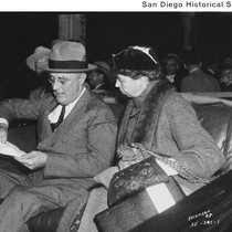 Franklin D. and Eleanor Roosevelt sitting in a car and looking at ...