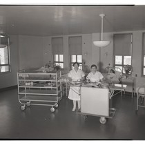 Kitchen staff in patient room at San Francisco General Hospital