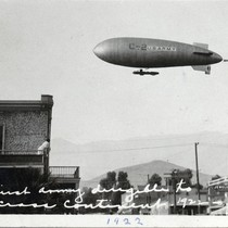 Army dirigible flying over downtown Banning, California