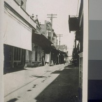 [Alley of Japanese shops within a Chinese commercial district?, Fresno, California.]