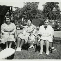 1940, Three Library Staff sitting outside in Lawn Chairs