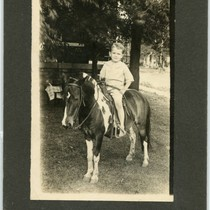 Norvel Young as a boy riding a pony, 1921