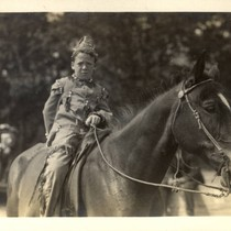 A boy on horseback and in costume during the second annual May ...