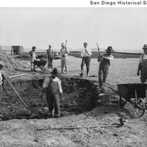 Adobe brick makers around a large mud pit used to make adobe ...