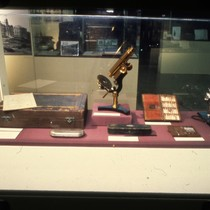 UCSF Origins of Excellence exhibit microscope and medicine kit display