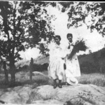 2 women standing in the country