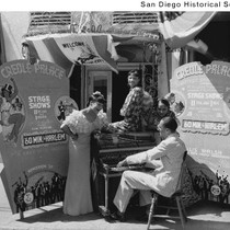 A man playing a piano with three women singing outside the Creole ...