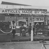 1910 Street Fair, Ainsworth Lumber & Milling Company booth, Orange, California