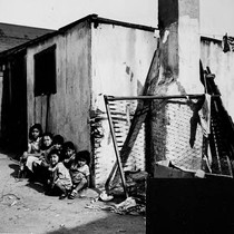 Children in front of dwelling exterior
