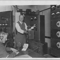 Prof. Charles Herrold operating radio equipment [ca. 1925]