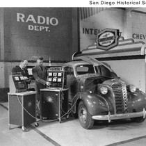 A 1937 Chevrolet being checked with diagnostic equipment used by a supervised ...
