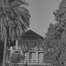 Two story house with palm tree, Walnut Grove