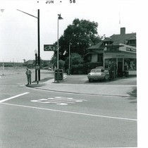 C. H. Lane on Street Corner at Flying A Service Station