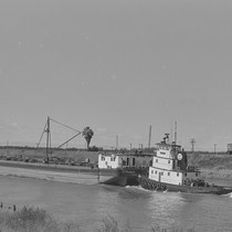 Tugboat pushing barge, from Walnut Grove: Portrait of a Town