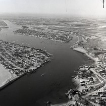 Aerial view of Balboa Island and Newport Harbor entrance, Newport Beach, California: ...