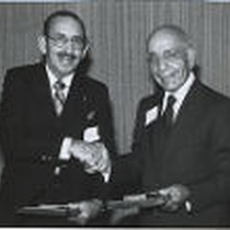 Aram and Leon Peters holding their Brick and Mortar Awards