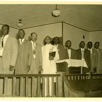 Group of men standing at church altar