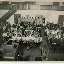 Attendees seated inside an unidentified church