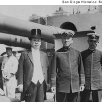 Admiral H. Saito, two sailors, and a Japanese man in formal wear ...