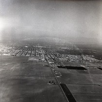 Aerial view of fields and orchards near Newport Beach, Orange County, California: ...