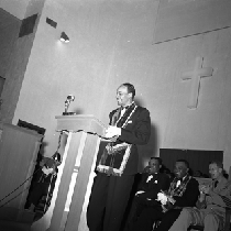 Al Fulcher standing at podium