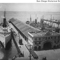 Aerial view of a ship tied to Municipal Dock