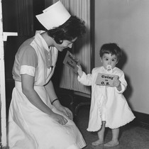 Nurse with child in St. Joseph's Hospital Pediatric Ward