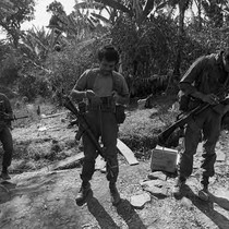 Three soldiers checking equipment, Perquín, Morazán, 1983