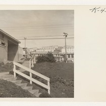 Entrance to the cafeteria and a section of the temporary housing units ...