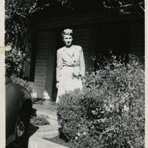 1940, Kathryn Williams standing in front of a brick building