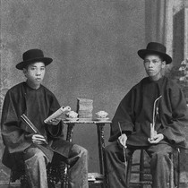 Two Chinese men seated at a table