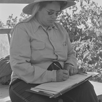 Woman in straw hat writing, from Walnut Grove: Portrait of a Town