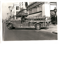 An Oakland Fire Department fire engine pulls onto 14th Street in front ...