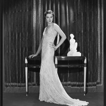 Actress Gail Patrick modeling a beaded evening gown, 1933
