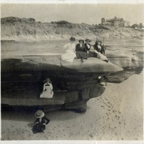 [Five women sitting on a sea cliff and one woman sitting on ...